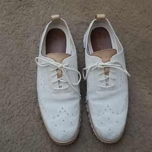 Cole Haan stitched light winged-tip white shoes